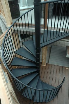 "The spiral staircase from ""Decked Out"" episode ""The Spiral Staircase Deck"".  Deck Design by Paul Lafrance Design."