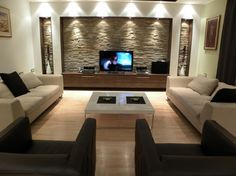 Stone wall feature cut outs in living room