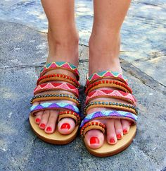 FREE SHIPPING! Coral Reef. This boho inspired pair of sandals is composed of genuine Greek leather, anti-slip anatomic rubber sole, candy swarovski crystals and friendship bracelets in fresh red and aqua tones. Give a tropical boho vibe to your summer outfits with this quality pair