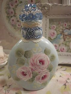 Hand painted pink roses on blue bottle with glass beaded top and velvet ribbon....pretty!