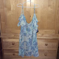 Urban Outfitters blue floral dress Light weight baby blue floral dress. New with tags Urban Outfitters Dresses Mini