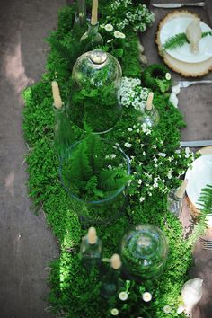 lush greenery, photo by Arina B Photography http://ruffledblog.com/greenery-filled-wedding-ideas #tablescapes #tablerunners #ferns