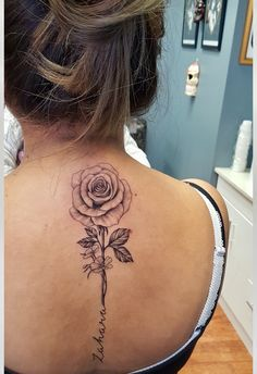 This tattoo is a dedication to my baby girl  - her name Zahara means a flower in bloom #spinetattoo #flowertattoo #blackandgrey #tattoo #girlswithtattoo #backtattoo #rosetattoo #representingmychildsname