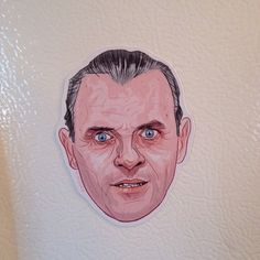 Hannibal Lecter Fridge Magnet by CastleMcQuade on Etsy.  He'll protect your fava beans.