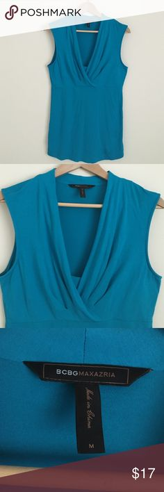 "BCBGMaxAzria M sleeveless teal V-neck rayon top BC BG Max as Rea size medium sleeveless the knack teal top this trendy aqua colored teal colored rayon top features beautiful V-neck with empire waist and there are three pleats coming out from the empire waist up to the v-neck giving it a flattering gathered look. Dimensions include 32 inches across the shoulders 30"" in length, 32"" bust,  30"" waist, and 34"" hips. BCBGMaxAzria Tops Tunics"