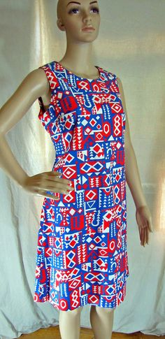 Sweet, mod, vintage 1960s, cotton, red white and blue, op art, bold abstract pattern, modern clean cut, shift dress, scoop neck, sleeveless,…