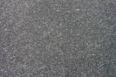 texture of organic dark grey paper for artwork with numerous natural