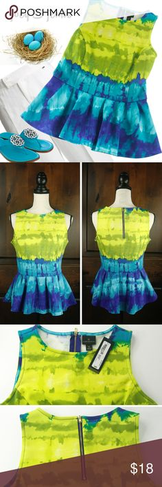 """*NEW LISTING* NWT Turquoise & Green Top Medium You will feel cute and sassy in this top! NWT, Retail $40.00. Very nice fabric that will give a smooth fit. Contrasting zipper in the back. Ruffled flare at bottom. ● Size Medium. Length 24"""", Bust 18"""" laid flat, Waist 15"""". I believe this top runs big.  My dress form is Medium and you can see it is a little large.  ● 93% Polyester, 7% Spandex. Machine wash cold, tumble dry low. ●  Bundle 2 or more items for 15% off. Free shipping for orders over…"""