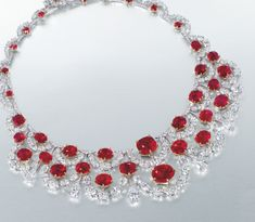 The Crimson Garland necklace, designed by Etcetera, is comprised of two rows of oval-shaped diamond swags and contains two cushion-shaped rubies, each weighing over 10 carats. Description from pinterest.com. I searched for this on bing.com/images