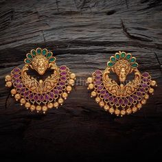 Designer earrings studded with synthetic ruby green stones, plated with gold polish, made of copper alloy Gold Jhumka Earrings, Indian Jewelry Earrings, Jewelry Design Earrings, Gold Earrings Designs, Gold Jewellery Design, Bead Jewellery, Antique Earrings, Bridal Earrings, Gold Jewelry