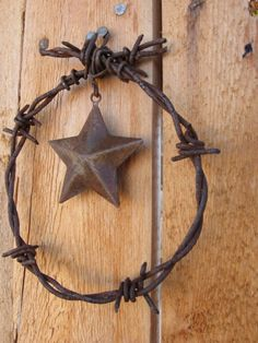 barbed wire wreath Christmas ornament with star by jackrabbitflats
