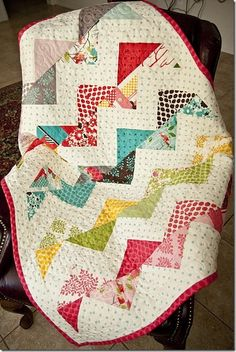 zig zag quilt with different fabrics...Cathy, what about this one with  a common background for the baby quilt......chevron is all the rage right now.