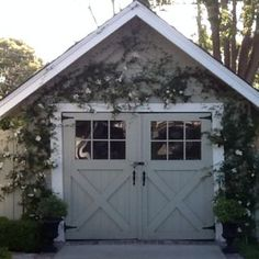Side hinged wooden garage door with window panels, giving completely carriage…