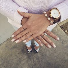 Nude nails and gold jewelry.
