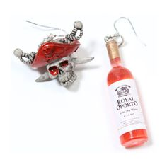 Pirate earrings in red and silver http://www.attitudeholland.nl/haar/accessoires/sieraden/oorbellen/piraten-doodskop-en-wijnfles-oorbellen-zac-s-alter-ego/
