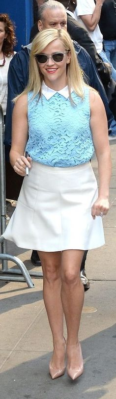 Reese headed to Good Morning America in her Charlotte lace top which she tucked into a white mini skirt and completed with neutral pumps.