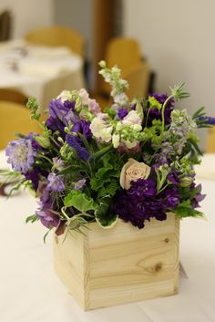 purple blooms in raw wooden crate | Erin Volante Floral