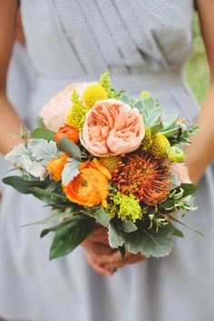 Peach and orange against this soft gray dress is perfection: http://www.stylemepretty.com/little-black-book-blog/2014/10/13/preppy-romance-at-natures-point-on-lake-travis/ | Photography: Diana M. Lott - http://www.dianamlottphotography.com/
