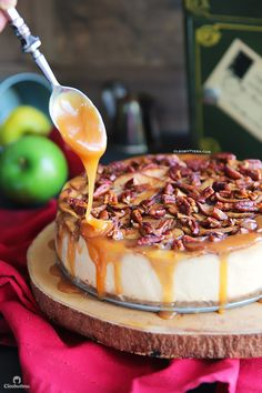 Apple Pecan Cheesecake: An exceptionally creamy cheesecake with a topping that tastes like a mash up between apple pie and pecan pie. A drizzle of salted caramel sauce takes this dessert from amazing to irresistible!
