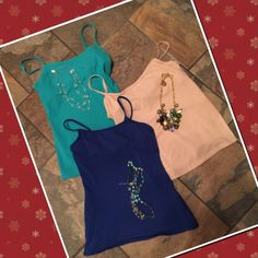 Bra top cami's One cream colored and one aqua Victoria Secret bra top cami and one royal blue Express bra top cami.  Worn one time - excellent condition - like new. No stains, pulls or odors. Super soft stretch cotton. Machine wash and tumble dry. Victoria's Secret Tops Camisoles