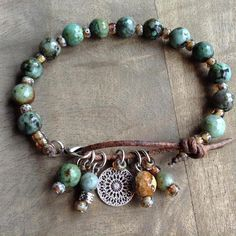 This gemstone bracelet is made with, African turquoise beads , Miyuki beads, leather a metal clasp and a metal boho charm. Fits a wrist of 18 cm = 7.08 inch. Please read my policies before ordering.