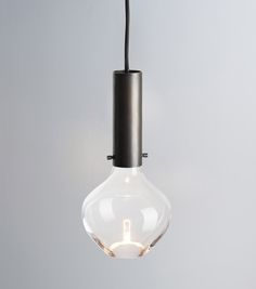 """Moni"" pendant with handblown glass and hidden light source, browned brass cylinder/ isabel hamm licht"