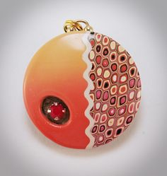 Polymer clay.  Brass findings, re-purposed jewel from a brooch.  Barbara Colautti