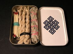 Sage smudging kit in an Altoids tin, with sandpaper match-striking surface attached to outside- genius!