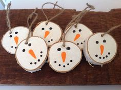 Six adorable and whimsical snowman ornaments made from Birch log slices. Each is Handpainted and ready to hang.