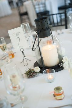 Lantern centerpieces and table numbers | Erica Hasenjager Photography