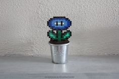 Fleur Mario bleue en perles à repasser Blue Flower beads Hama Mario, Diy Fleur, Hanukkah, Wreaths, Crafts, Craft Ideas, Blue Flowers, Fimo, Quirky Gifts
