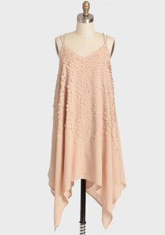 Cute handkerchief dress with a simple paillette texture