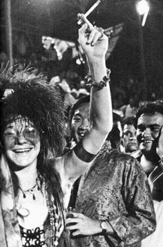 Janis Joplin. (that guy behind her arm looks like Mr. Chow from The Hangover...tima travel?)