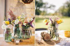 Jam jars and wildflowers wedding decor. Visit www.rosetintmywedding.co.uk for bespoke wedding planning and design.