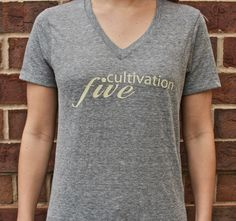 Girls V-Neck Eco Grey - Cultivation Five is a T-shirt line that joins style, comfort and class with giving back to the community.  Partnering with children's charities, the company donates $5 to the charity chosen by you, the consumer, with each T-shirt sold.  With your purchase, you will also be provided with a handmade drawstring bag.  #C5 #CharityFashion #GiveBack