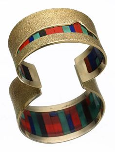 Cuff | Charles Loloma. 14 karat gold textured top, pierced through the center to reveal inlays of turquoise, coral, lapis and ironwood.