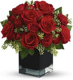 Lush, lavish and spectacularly chic, this gorgeous contemporary bouquet of red roses in a stunning black cube vase makes an exciting gift for almost anyone. Wouldn't you love for someone to send it to you?    The brilliant bouquet includes red roses and red spray roses.    Delivered in a black contemporary glass cube vase.TFWEB596