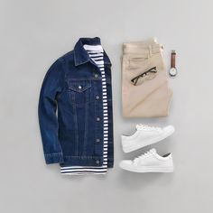 Not sure who created this flatlay but I like the tones of the casual combo with a denim jacket with a blue and white striped t shirt tan chinos glasses watch and white sneakers Mens Fashion Blazer, Sneakers Fashion, Men's Sneakers, White Sneakers, Cool Mens Sneakers, Running Sneakers, Stylish Mens Outfits, Stylish Mens Fashion, Tan Chinos
