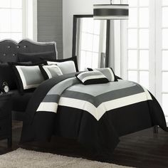Chic Home Dylan Queen Comforter Set In Black - Makeover your bedroom with the simple, yet stylish Chic Home Dylan Comforter Set. Adorned with a pieced color block design, the beautiful bedding instantly adds a fashionable flair to any room's décor.
