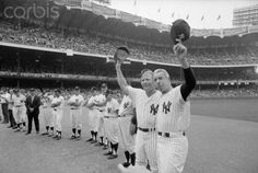 Mickey Mantle and Joe DiMaggio Holding up Their Caps Date Photographed: August 11, 1973