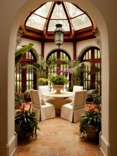 Breakfast room.  Atrium ceiling, window, and plants.