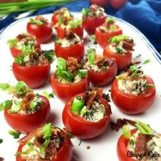 These easy Stuffed Cherry Tomatoes are filled with Bacon Asiago Cream Cheese. Served cold this is the perfect recipe idea for a summertime party. Also known as BLT Bites these stuffed cherry tomatoes are always a big hit Tomato Appetizers, Cold Appetizers, Seafood Appetizers, Finger Food Appetizers, Appetizers For Party, Appetizer Recipes, Cheese Appetizers, Vegetable Appetizers, Christmas Appetizers