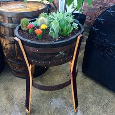 Just made this wine barrel planter for our new plants!