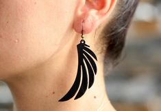 This is a laser cut wing earring made from vegetable tanned cowhide leather. The cut out teardrop is about 2 in height and it's width is less then an inch Thanks for stopping by! Leather Ring, Leather Earrings, Leather Jewelry, Wing Earrings, Etsy Earrings, Dangle Earrings, Foot Bracelet, Eagle Wings, Jewelry Crafts