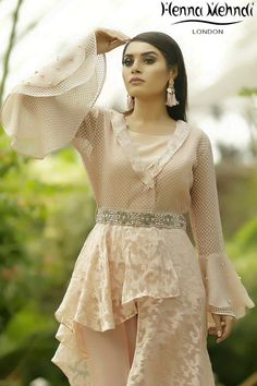 Pink embroidered and broche organza high low side peplum top with pearl and crystal embroidery on collars and sleeves complimented with an embroidered belt. Included is a pink inner shirt. Pakistani Dresses Casual, Pakistani Wedding Dresses, Pakistani Clothing, Trendy Dresses, Fashion Dresses, Long Dresses, Trendy Outfits, Formal Dresses, Mahira Khan Dresses