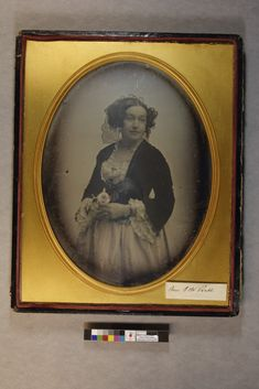 Mrs. G. (?) W. Pratt | Daguerreotypes collection, ca. 1845-1865 (PC005) -- Historic New England Portrait of a Mrs. G.W. Pratt (1817-1887) a popular actress who settled in Boston, in fancy dress, lace hair ornament and holding a wild rose.