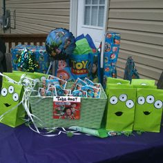 Alien gift bags for toy story birthday party... Made with white copy paper, a sharpie, and hot glue.
