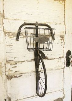 This vintage inspired metal bicycle wall art exudes loads of charm!! It would look perfect in a kitchen, family room, mud room or as a cute centerpiece in a childs room! The front basket is the perfect size for filling with whatever goodies your heart desires. I love the look of the vintage name plate on the front, looks great plain or would be neat with a name, significant date, monogram, etc. Ive taken some images with the basket filled just to give you an idea of how it looks with items…