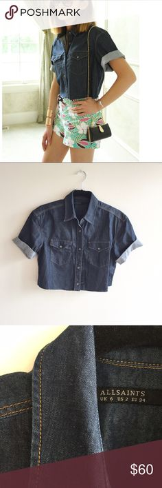 """[allsaints] dark rinse snap button denim crop This dark rinse denim crop top by Allsaints features snap-on buttons, 2 front pockets w flaps, rolled up sleeves, and frayed hem. It's boxy, loose fit and would best fit size 2-4. Looks adorable when worn with bold pattern shorts. Shoulder to shoulder: 18"""", shoulder to hem 16"""", pit to put 19"""". Excellent like-new condition All Saints Tops Crop Tops"""