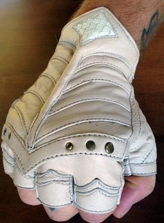 - Info - Size Chart - These new En(Armored) gloves have many layers of super soft Cabretta leather stitched and moulded to be raised off the back of the hand. With articulated thumb panels, and a extr